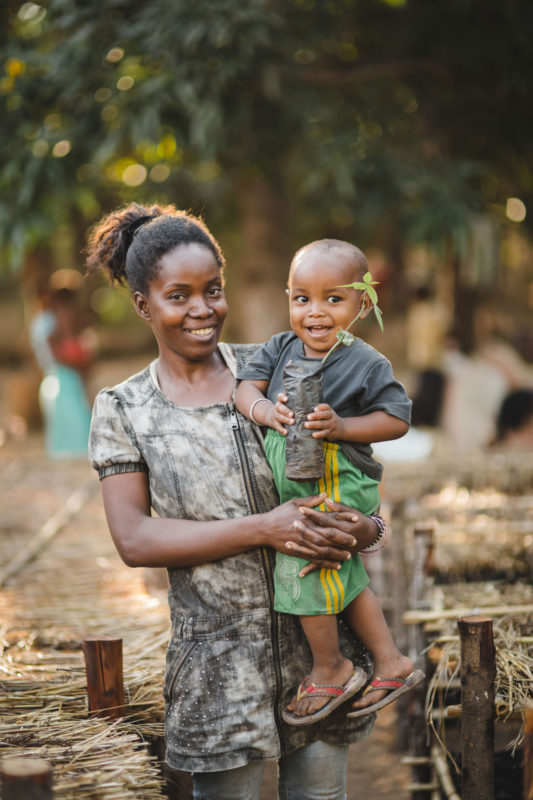 mom holding kid
