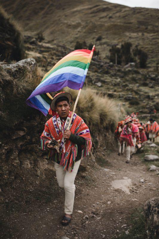 man with rainbow flag