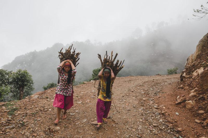 women walking with firewood]