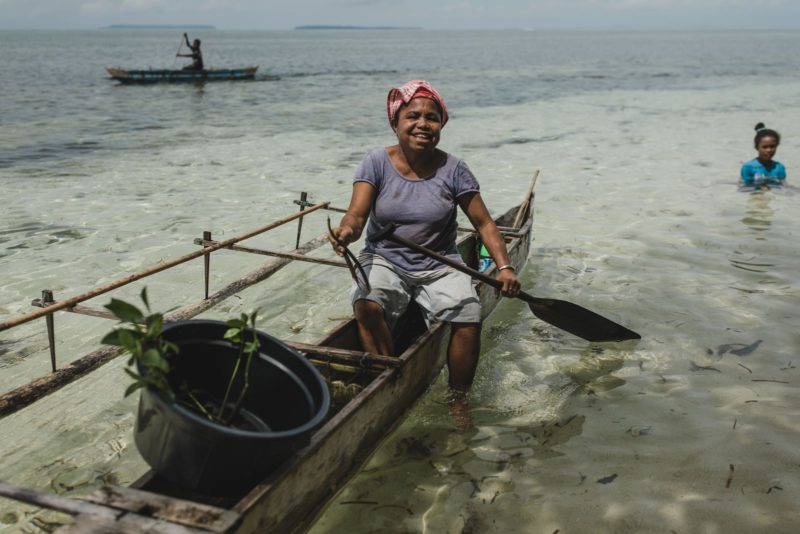 lady in boat with mangrove