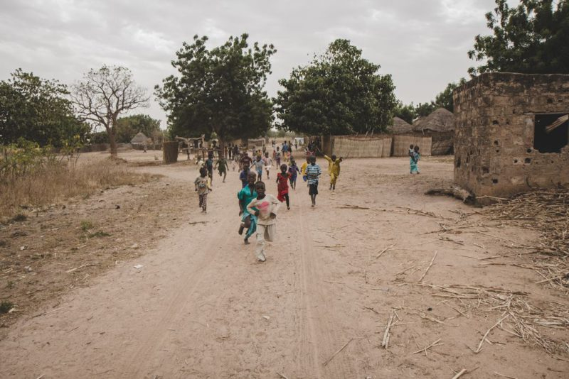kids running in village