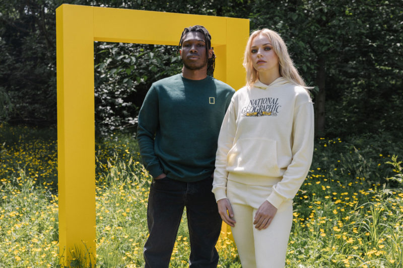 man and woman in national geographic sweater
