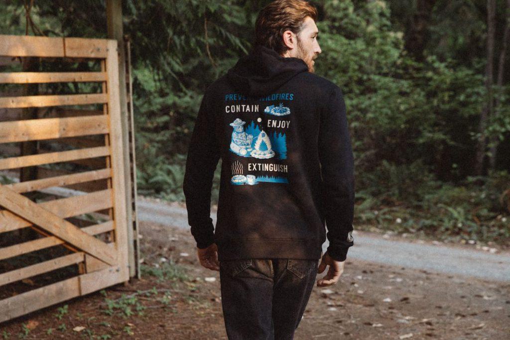man in smokey bear sweater